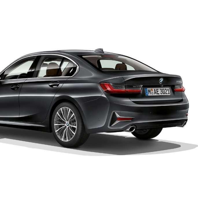 Three-quarter rear shot of the BMW 3 Series Sedan with Model Luxury Line features.